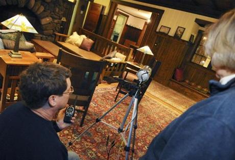Paranormal investigators Jim Stonier and Susan Yeates set up an infrared camera in a building at Veasey Memorial Park.